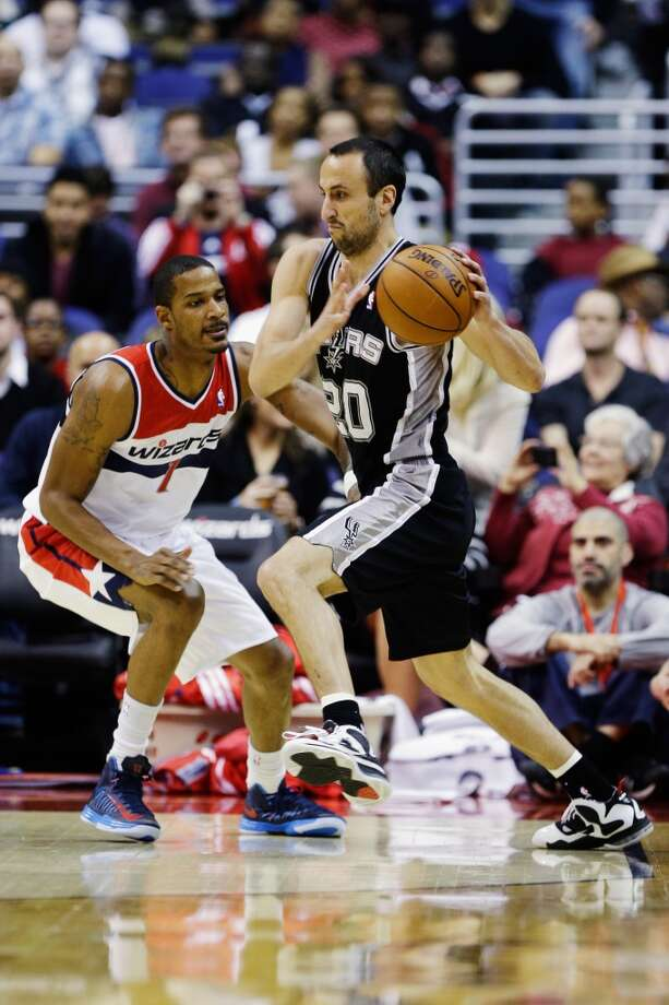 WASHINGTON, DC - NOVEMBER 26: Manu Ginobili #20 of the San Antonio Spurs drives around Trevor Ariza #1 of the Washington Wizards during the first half of their game at Verizon Center on November 26, 2012 in Washington, DC. NOTE TO USER: User expressly acknowledges and agrees that, by downloading and/or using this photograph, user is consenting to the terms and conditions of the Getty Images License Agreement.  (Photo by Rob Carr/Getty Images) (Getty Images)