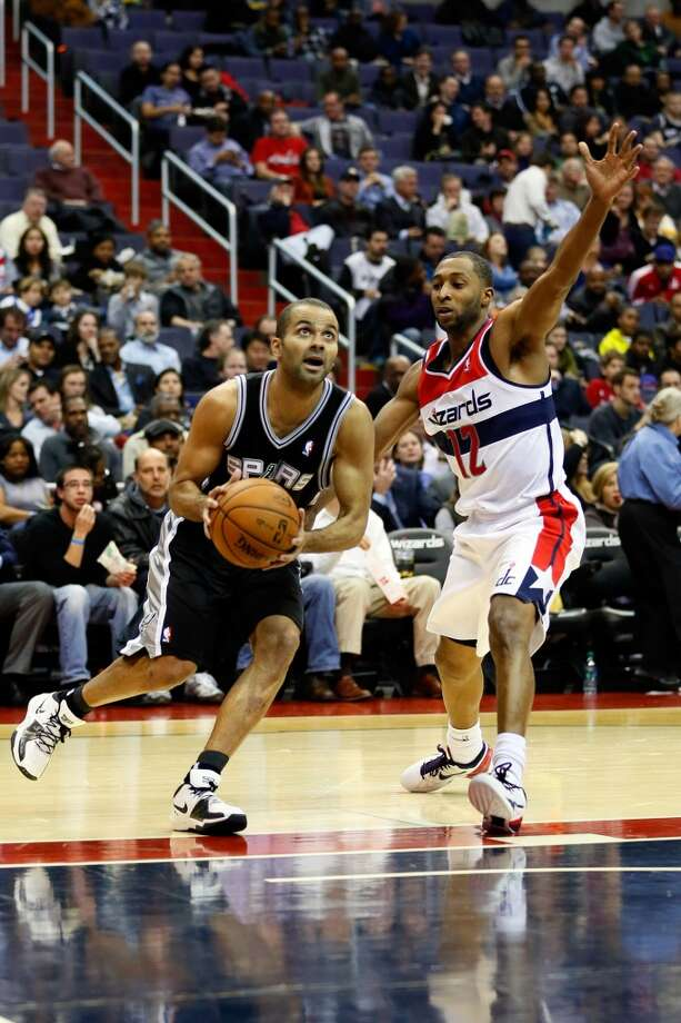 WASHINGTON, DC - NOVEMBER 26:  Tony Parker #9 of the San Antonio Spurs goes to the basket  in front of A.J. Price #12 of the Washington Wizards during the second half of the Spurs 118-92 win at Verizon Center on November 26, 2012 in Washington, DC. NOTE TO USER: User expressly acknowledges and agrees that, by downloading and/or using this photograph, user is consenting to the terms and conditions of the Getty Images License Agreement.  (Photo by Rob Carr/Getty Images) (Getty Images)