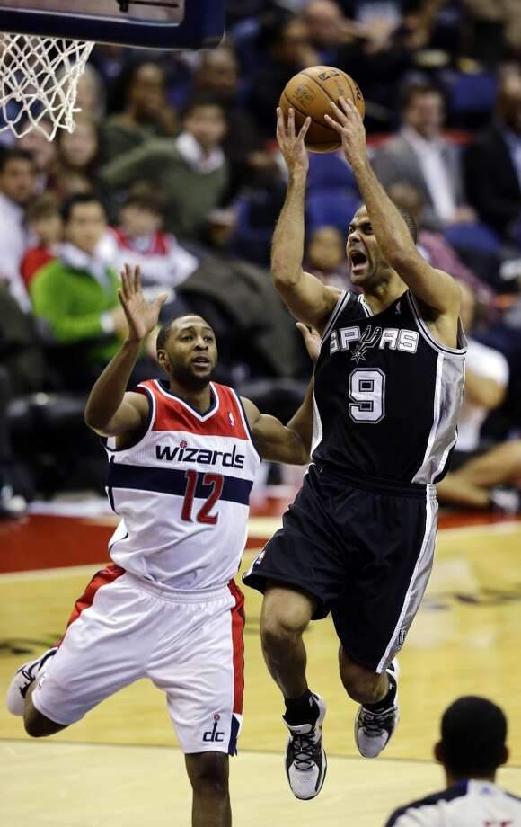 San Antonio Spurs guard Tony Parker shoots past Washington Wizards guard A.J. Price in the second half of an NBA basketball game Monday, Nov. 26, 2012, in Washington. The Spurs won 118-92. The Wizards are now 0-12. (AP Photo/Alex Brandon) (Associated Press)