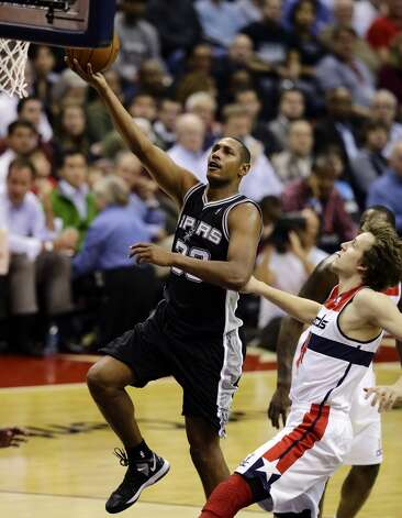 San Antonio Spurs center Boris Diaw, from France, shoots as he get past Washington Wizards forward Jan Vesely, from the Czech Republic, in the second half of an NBA basketball game Monday, Nov. 26, 2012, in Washington. The Spurs won 118-92. The Wizards are now 0-12. (AP Photo/Alex Brandon) (Associated Press)