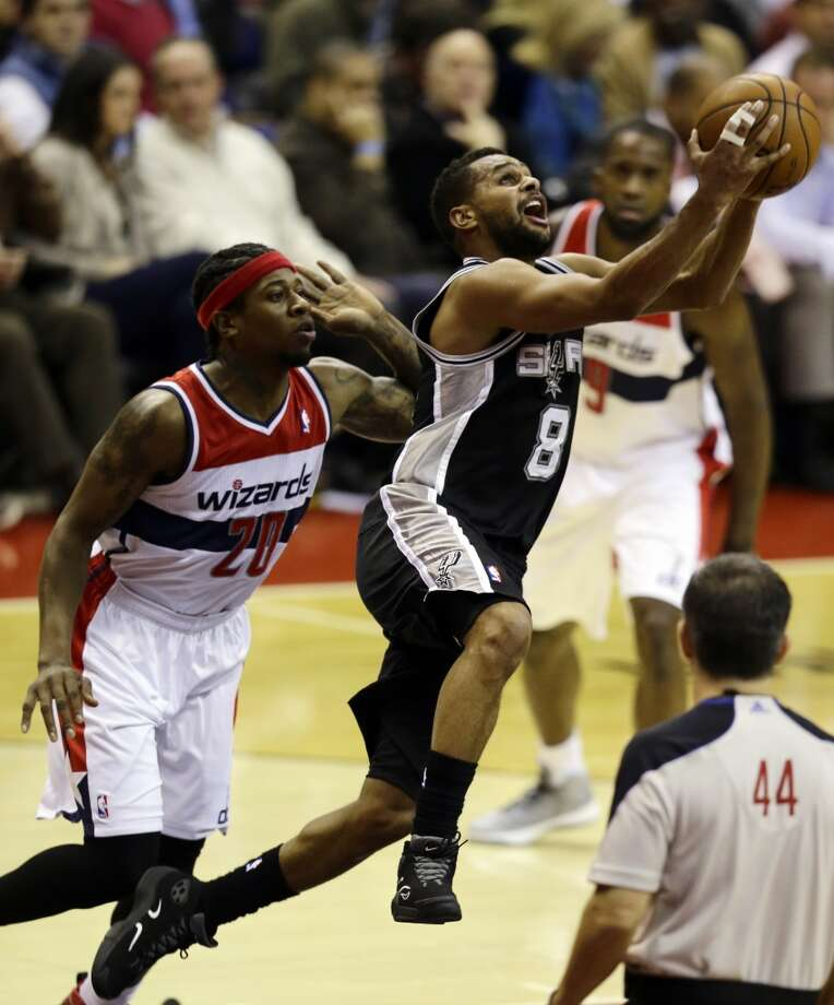 San Antonio Spurs guard Patty Mills, from Australia, shoots as he guarded by Washington Wizards forward Cartier Martin in the second half of an NBA basketball game Monday, Nov. 26, 2012, in Washington. The Spurs won 118-92. The Wizards are now 0-12. (AP Photo/Alex Brandon) (Associated Press)