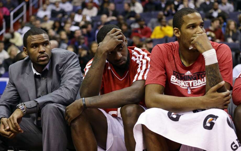 Washington Wizards forwards Trevor Booker, left, Martell Webster, and Trevor Ariza watch from the bench in the second half of an NBA basketball game against the San Antonio Spurs Monday, Nov. 26, 2012, in Washington. The Spurs won 118-92. The Wizards are now 0-12. (AP Photo/Alex Brandon) (Associated Press)