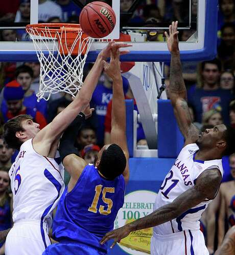 Kansas' Jeff Withey, left, gets one of his 12 blocks against San Jose State's Chris Cunningham. Photo: Rich Sugg, MBR / Kansas City Star