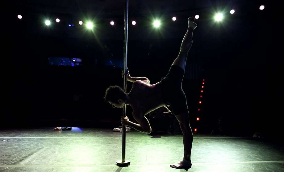 A participant rehearses his routine before competing in the South American Male category of the Miss Pole Dance South America 2012 and Pole Dance Argentina 2012 in Buenos Aires, Argentina, Monday, Nov. 26, 2012. (AP Photo/Natacha Pisarenko) Photo: Natacha Pisarenko, Associated Press