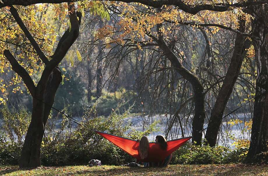 Ally Rush, 24, left, and Kirsten Elwick, 20, both of Redding, Calif., enjoy the weather in Elwick's hammock Monday, Nov. 26, 2012, at Caldwell Park, Redding, Calif. Photo: Andreas Fuhrmann, Associated Press