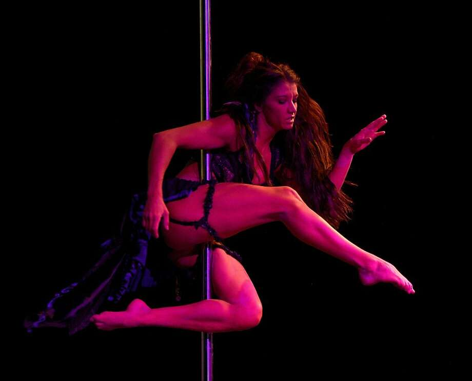 Pole dancer Zoraya Judd of the US, a member of the jury of the Miss Pole Dance Argentina and South America 2012 competition, performs before the awards ceremony in Buenos Aires on November 26, 2012.    AFP PHOTO / Juan MabromataJUAN MABROMATA/AFP/Getty Images Photo: Juan Mabromata, AFP/Getty Images