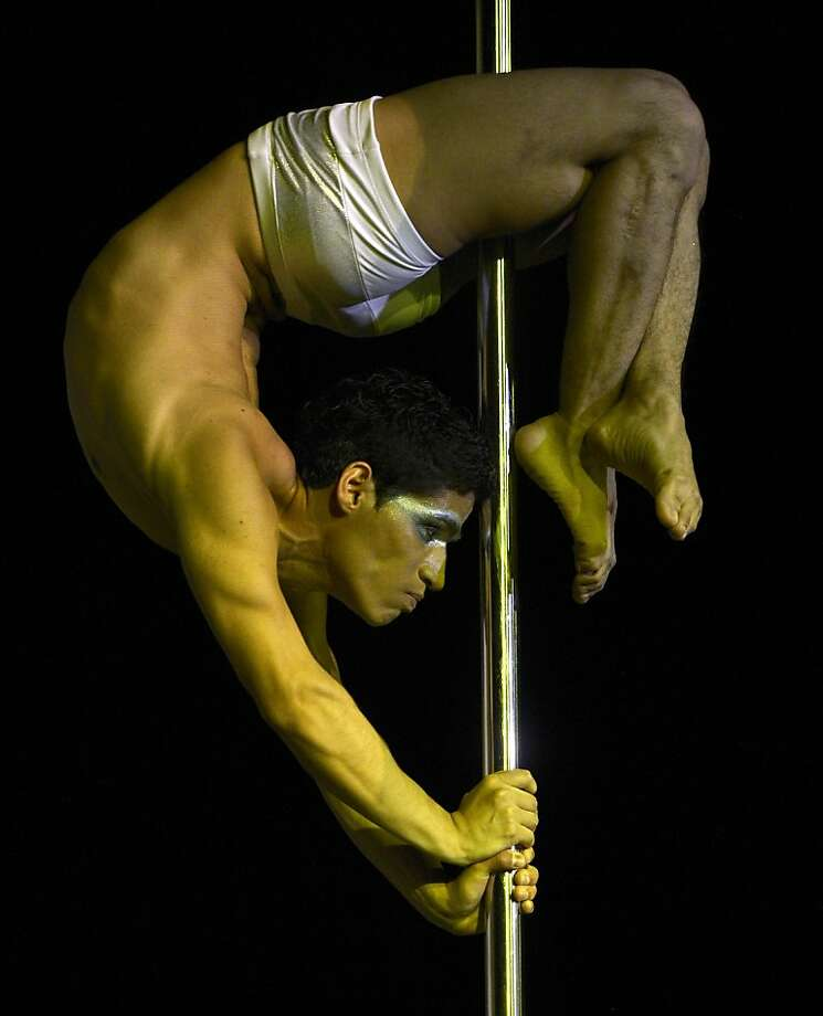 Pole dancer Renzo Zerga of Peru competes in the Pole Dance South America 2012 competition in Buenos Aires on November 26, 2012.    AFP PHOTO / Juan MabromataJUAN MABROMATA/AFP/Getty Images Photo: Juan Mabromata, AFP/Getty Images