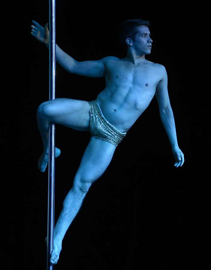 Pole dancer Felipe Mendoza of Chile competes to take second place in the Pole Dance South America 2012 competition in Buenos Aires on November 26, 2012.    AFP PHOTO / Juan MabromataJUAN MABROMATA/AFP/Getty Images Photo: Juan Mabromata, AFP/Getty Images