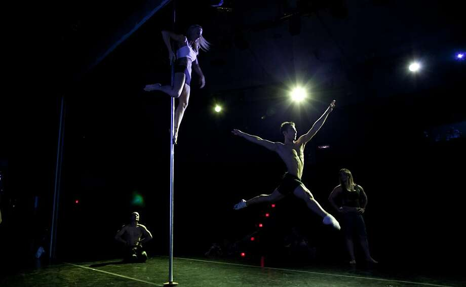 Participants rehearse before competing in the Miss Pole Dance South America 2012 and Pole Dance Argentina 2012 in Buenos Aires, Argentina, Monday, Nov. 26, 2012. (AP Photo/Natacha Pisarenko) Photo: Natacha Pisarenko, Associated Press