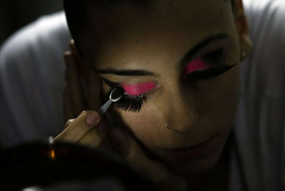 Pole dancer Alessandra Ranca, of Brazil, applies make up before competing in the Miss Pole Dance South America 2012 in Buenos Aires, Argentina, Monday, Nov. 26, 2012. (AP Photo/Natacha Pisarenko) Photo: Natacha Pisarenko, Associated Press