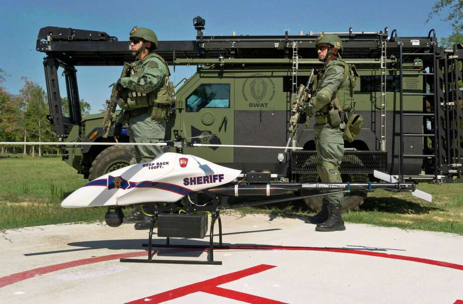 This Sept. 2011 photo provided by Vanguard Defense Industries, shows a ShadowHawk drone with Montgomery County SWAT team members. Photo: AP Photo, Lance Bertolino,  Vanguard Defense Industries / Vanguard Defense Industries