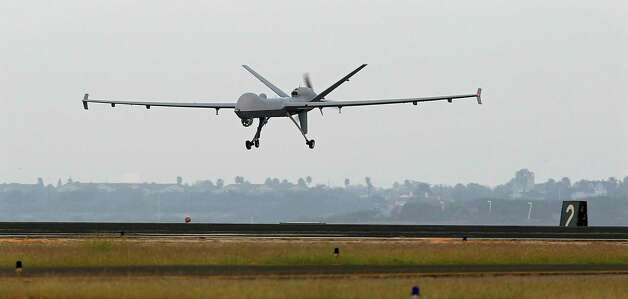 A Predator B unmanned aircraft lands after a mission at the Naval Air Station last year in Corpus Christi. Photo: Eric Gay, Associated Press / AP