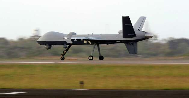 A Predator B unmanned aircraft lands after a mission at the Naval Air Station, Tuesday, Nov. 8, 2011, in Corpus Christi. Photo: Eric Gay, Associated Press / AP