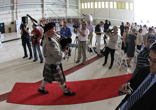 A ceremony along with a bag pipe player officially marks the beginning of unmanned aircraft flights in Texas on Wednesday, Sept. 8, 2010, at the Naval Air Station in Corpus Christi. U.S. Customs and Border Protection obtained Certificates of Authorization from the Federal Aviation Administration to operate the MQ-9 Predator B aircraft along the Texas-Mexico border. Photo: Kin Man Hui, San Antonio Express-News / kmhui@express-news.net