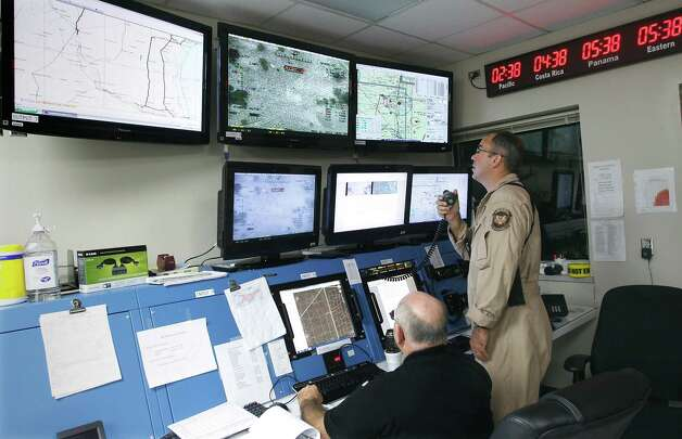 U.S. Customs and Border Protection Agent William (right) monitors the activities of a Predator B unmanned aircraft at the Naval Air Station, Tuesday, Nov. 8, 2011, in Corpus Christi. Photo: Eric Gay, Associated Press / AP