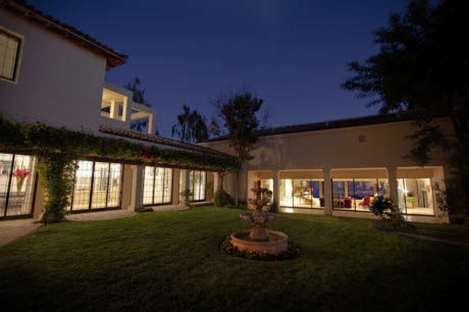 The house has several wings surrounding a courtyard. (Prudential California Realty)