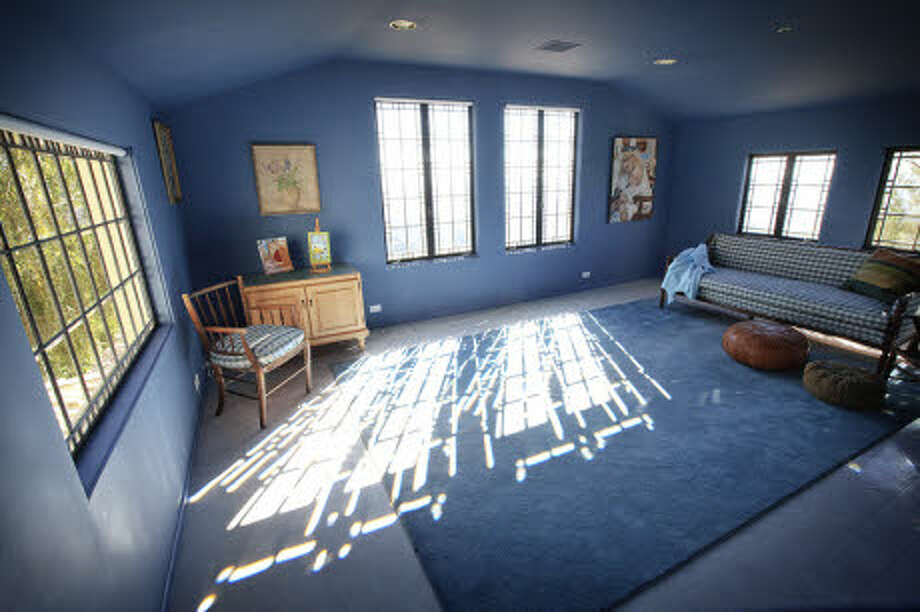 This bedroom is more modestly decorated. (Prudential California Realty)
