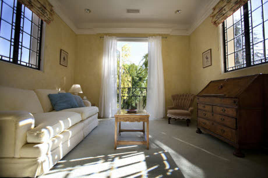 This looks like a sitting room that goes with a bedroom. (Prudential California Realty)