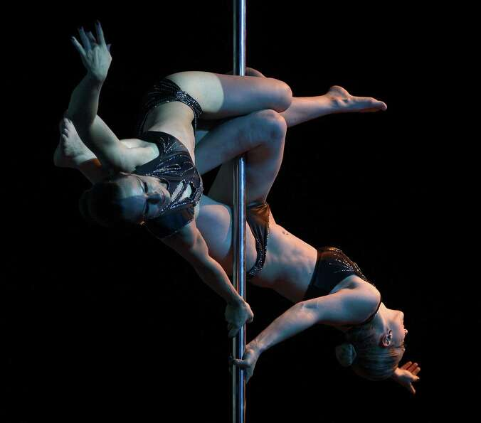 Brazilian pole dancers Karen Horbus and Soeli Coradassi compete to finish in second place in the Pol