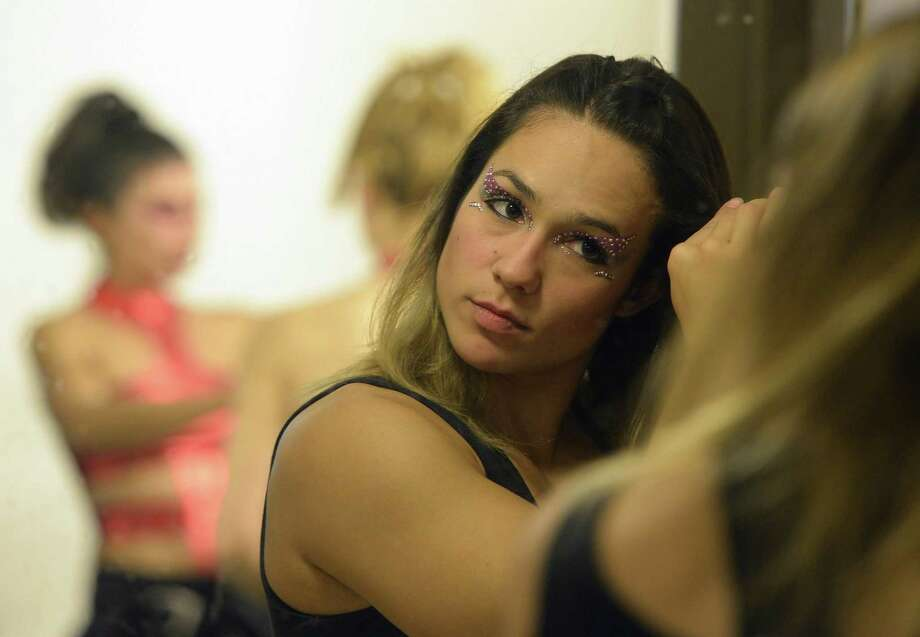Brazilian pole dancer Rafaela Montanaro gets ready backstage during the Miss Pole Dance Argentina and South America 2012 competition in Buenos Aires on November 26, 2012. AFP PHOTO / Juan MabromataJUAN MABROMATA/AFP/Getty Images Photo: JUAN MABROMATA, AFP/Getty Images / AFP