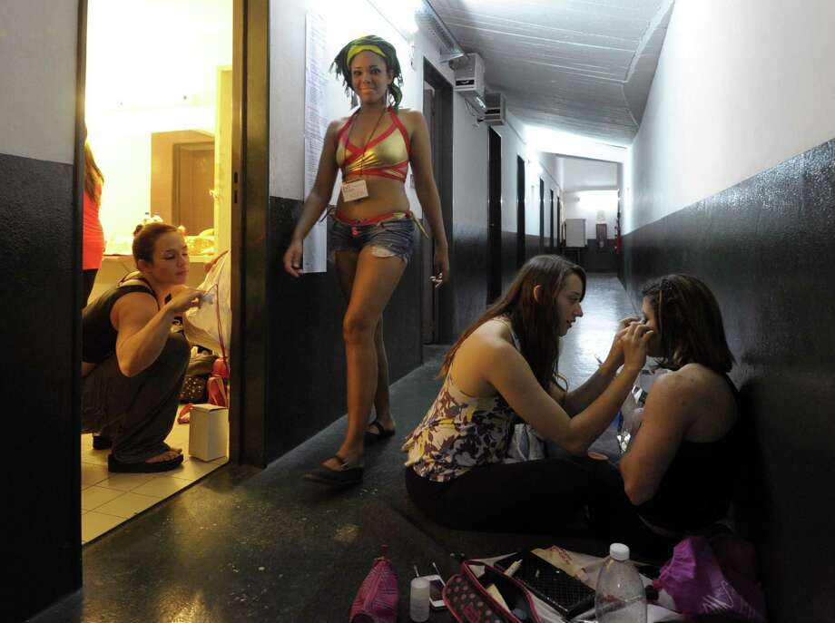 Brazilian pole dancers get ready backstage during the Miss Pole Dance Argentina and South America 2012 competition in Buenos Aires on November 26, 2012. AFP PHOTO / Juan MabromataJUAN MABROMATA/AFP/Getty Images Photo: JUAN MABROMATA, AFP/Getty Images / AFP