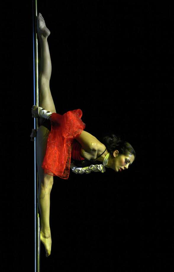 Peruvian pole dancer Ximena Ribero competes to finish in third place in the Miss Pole Dance South America 2012 competition as well as win the Best Artistic Performance trophy in Buenos Aires on November 26, 2012. AFP PHOTO / Juan MabromataJUAN MABROMATA/AFP/Getty Images Photo: JUAN MABROMATA, AFP/Getty Images / AFP