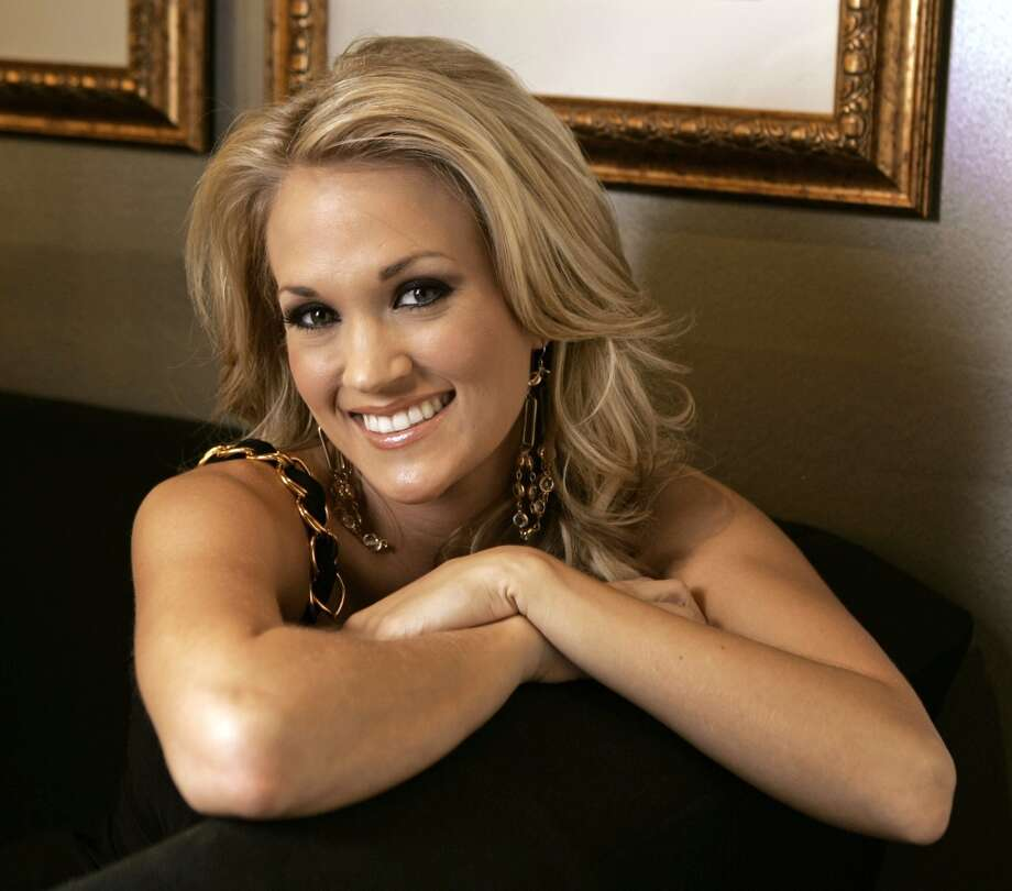 Carrie Underwood is photographed at the Grand Ole Opry in Nashville, Tenn., Oct. 9, 2007. The former American Idol winner admits to having a few butterflies before the release of her second album, Carnival Ride, which follows her debut album, Some Hearts, that sold 6 million copies. (AP Photo/Mark Humphrey) (AP)