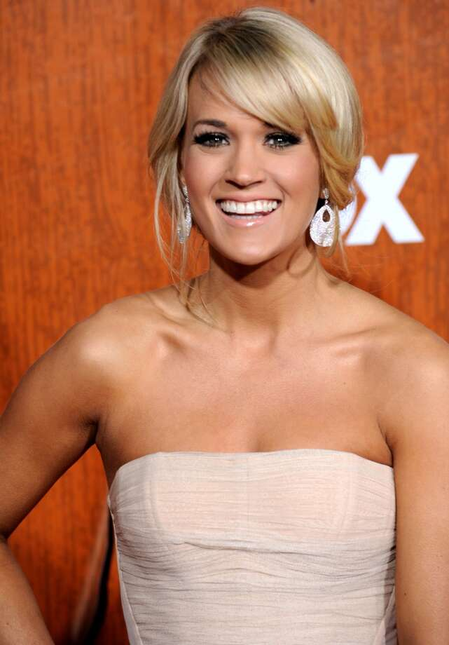 In this photo provided by the Las Vegas News Bureau, Carrie Underwood walks the red carpet at the American Country Awards at the MGM Grand Garden Arena in Las Vegas on Monday, Dec. 5, 2011. (AP Photo/Las Vegas News Bureau, Glenn Pinkerton) (AP)