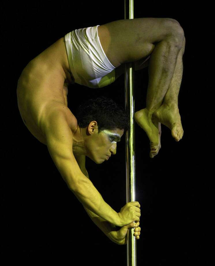 Pole dancer Renzo Zerga of Peru competes in the Pole Dance South America 2012 competition in Buenos Aires on November 26, 2012.    AFP PHOTO / Juan MabromataJUAN MABROMATA/AFP/Getty Images Photo: JUAN MABROMATA, AFP/Getty Images / AFP