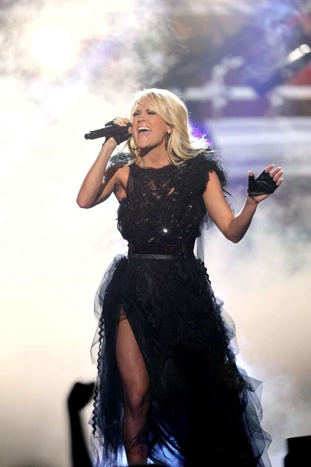"Carrie Underwood performs ""Two Black Cadillacs"" at the 40th Anniversary American Music Awards on Sunday, Nov. 18, 2012, in Los Angeles. (Photo by Matt Sayles/Invision/AP) (Matt Sayles/Invision/AP)"
