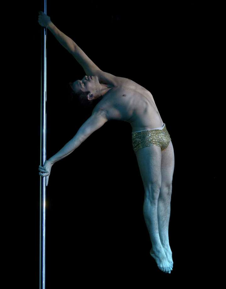 Pole dancer Felipe Mendoza of Chile competes to take second place in the Pole Dance South America 2012 competition in Buenos Aires on November 26, 2012.    AFP PHOTO / Juan MabromataJUAN MABROMATA/AFP/Getty Images Photo: JUAN MABROMATA, AFP/Getty Images / AFP