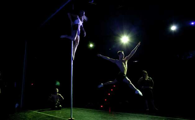 Participants rehearse before competing in the Miss Pole Dance South America 2012 and Pole Dance Argentina 2012 in Buenos Aires, Argentina, Monday, Nov. 26, 2012. (AP Photo/Natacha Pisarenko) Photo: Natacha Pisarenko, Associated Press / AP