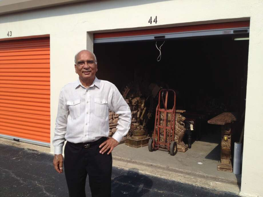 Surender Talwar, a Houston importer of Hindu and Buddhist statues, stands in front of the storage unit housing his wares (Photo: Ken Chitwood)