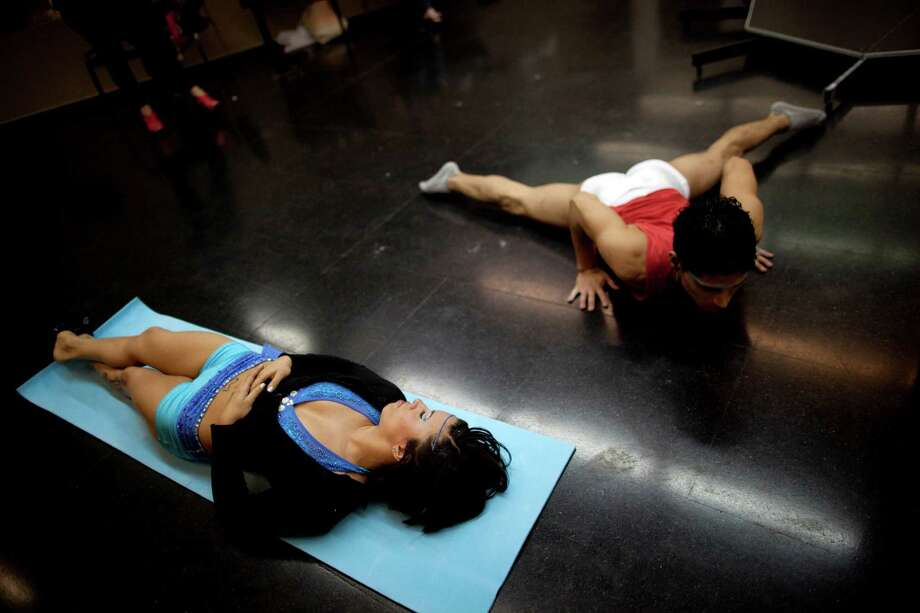 Participants of Miss Pole Dance South America 2012 and Pole Dance Argentina 2012 competitions stretch before their performances in Buenos Aires, Argentina, Monday, Nov. 26, 2012. (AP Photo/Natacha Pisarenko) Photo: Natacha Pisarenko, Associated Press / AP