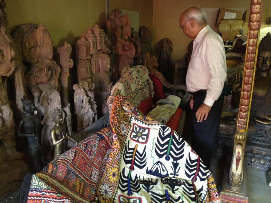 Mr. Talwar surveys his collection (Photo: Ken Chitwood)