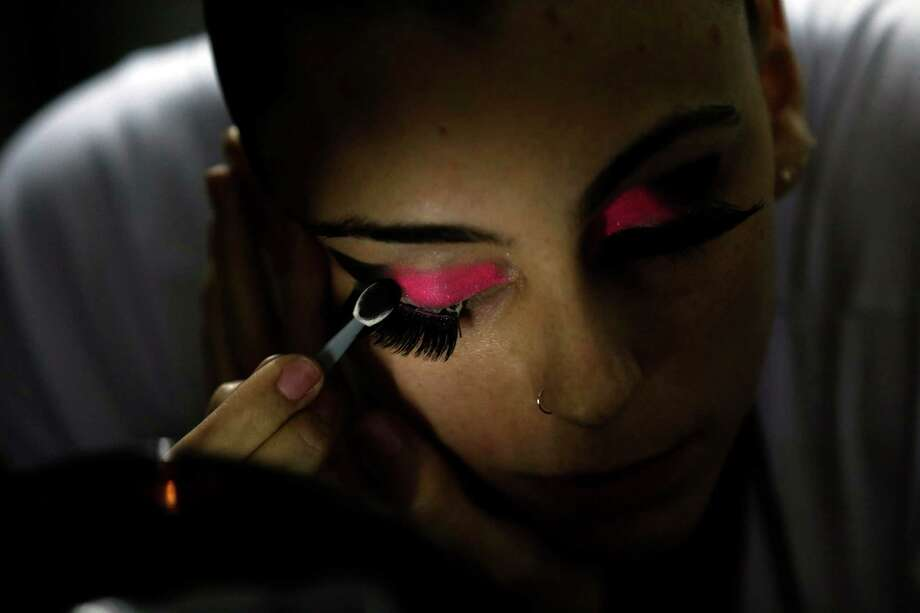 Pole dancer Alessandra Ranca, of Brazil, applies make up before competing in the Miss Pole Dance South America 2012 in Buenos Aires, Argentina, Monday, Nov. 26, 2012. (AP Photo/Natacha Pisarenko) Photo: Natacha Pisarenko, Associated Press / AP