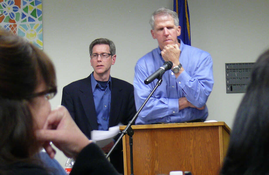 Mark Patten, left, vice chairman, and Tom McCarthy, chairman, of the Representative Town Meeting's Senior Tax Relief Committee explain changes to the legislative body Monday night. Fairfield CT 11/26/12 Photo: Genevieve Reilly / Fairfield Citizen