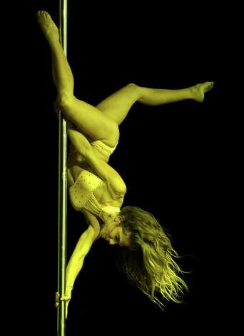 Chilean pole dancer Francisca Murillo competes in the Miss Pole Dance South America 2012 in Buenos Aires on November 26, 2012. Schmoll finished in second place. AFP PHOTO / Juan MabromataJUAN MABROMATA/AFP/Getty Images Photo: JUAN MABROMATA, AFP/Getty Images / AFP