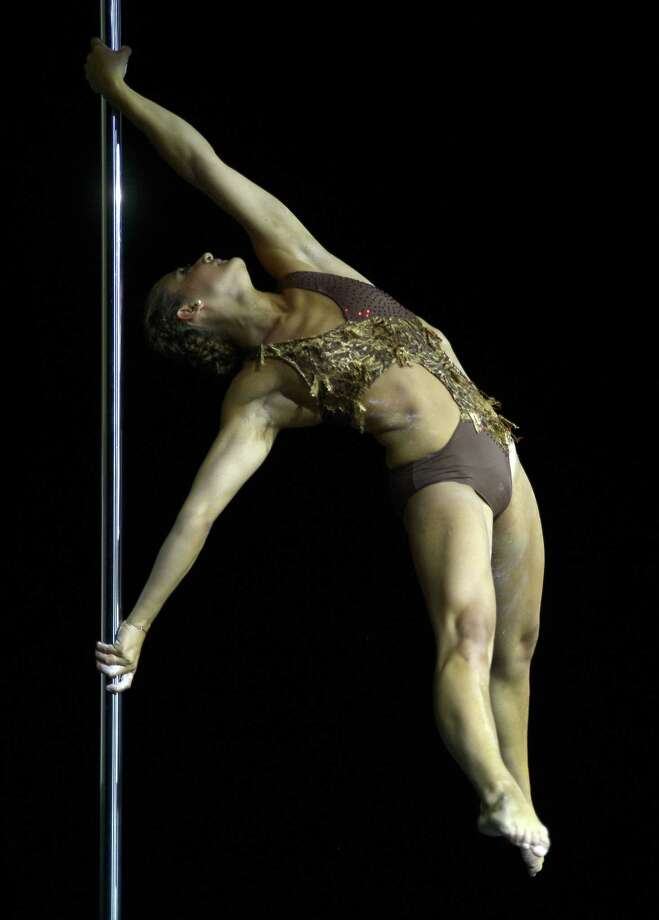 Argentine pole dancer Maria Rame competes to win the Miss Pole Dance Argentina 2012 and finishing in second place in the Miss Pole Dance South America competition in Buenos Aires on November 26, 2012. AFP PHOTO / Juan MabromataJUAN MABROMATA/AFP/Getty Images Photo: JUAN MABROMATA, AFP/Getty Images / AFP