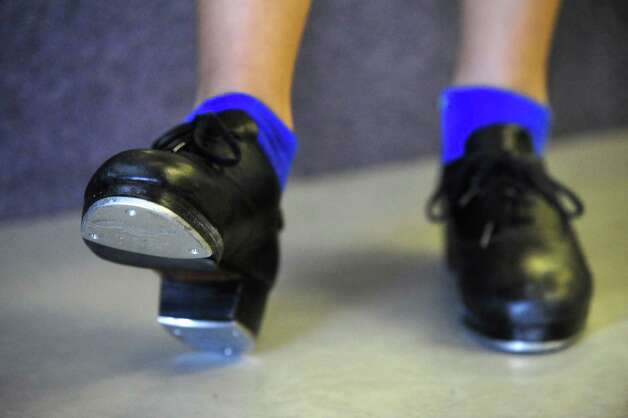These are the feet of Mckenna Beirne, 13, as she takes dance instruction at Seven Stars School for the Performing Arts in Brewster, N.Y., Monday, Nov.26, 2012. Photo: Michael Duffy / The News-Times