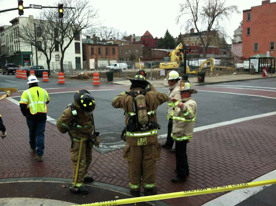 Firefighters survey the scene of a gas leak Tuesday, Nov. 27, 2012 at the corner of Congress and Third streets. Traffic was closed at the intersection. (Skip Dickstein / Times Union)