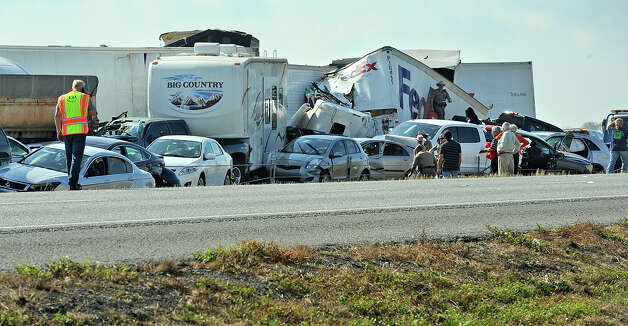 With more than 100 cars wrecked, the Interstate 10 pileup on Thursday is estimated to cost insurance companies more than a million dollars in damages. Photo taken Thursday, November 22, 2012 Guiseppe Barranco/The Enterprise Photo: Guiseppe Barranco, STAFF PHOTOGRAPHER / The Beaumont Enterprise
