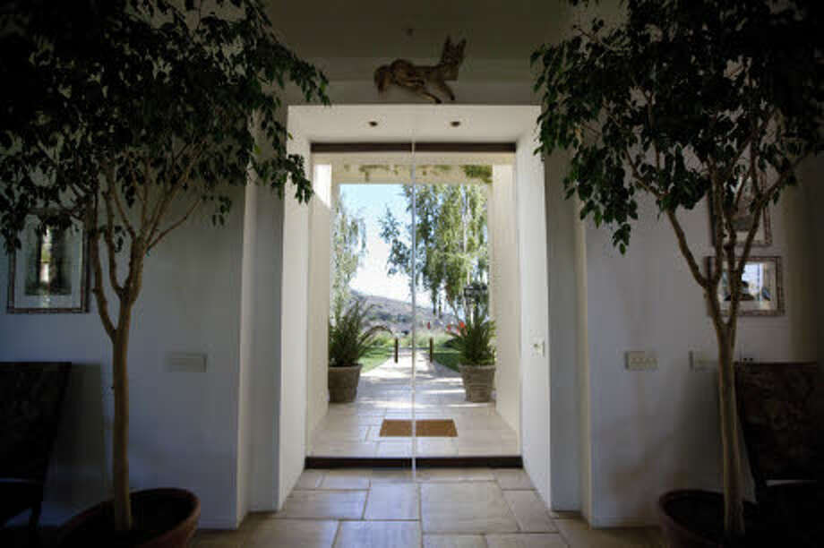 Is that taxidermy or a statue over the door? (Prudential California Realty)
