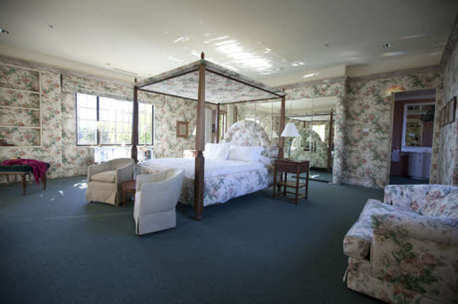 A very floral bedroom -- even the shelves are wallpapered. (Prudential California Realty)