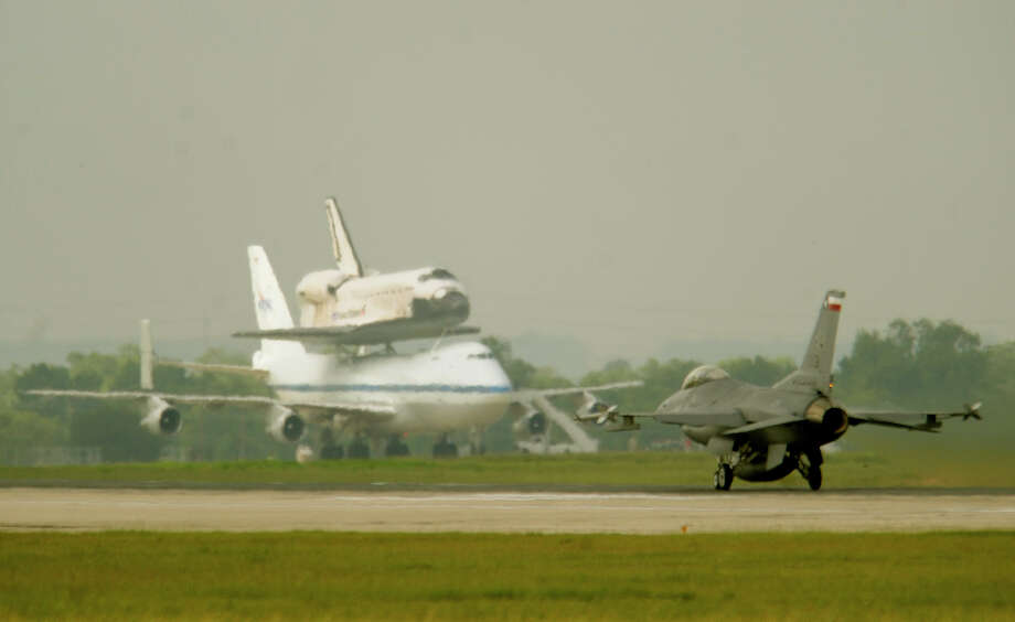 A Texas National Guard F-16 takes off by the Space Shuttle at Lackland Air Force Base in 2009. According to the U.S. Air Force website the F-16 cost $18.8 million per plane in 1998. Winning the Powerball jackpot would get you about 30 of the fighters. Fuel, bombs and bullets are extra. Photo: Express-News