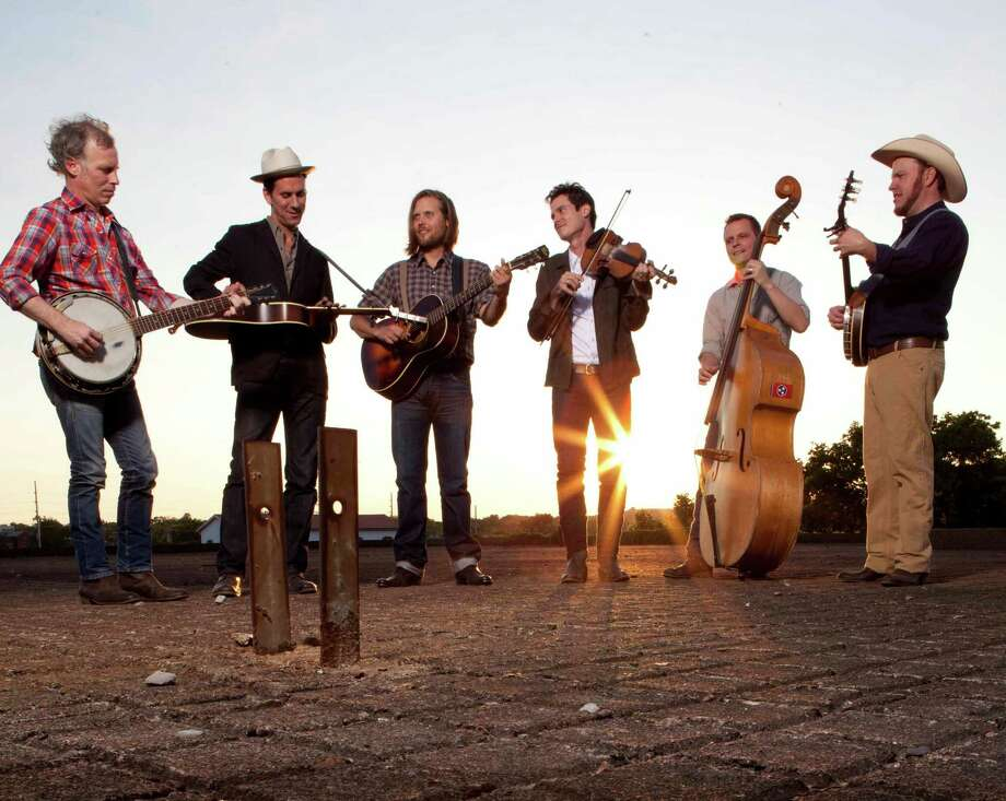 Old Crow Medicine Show band members Kevin Hayes (from left), Gill Landry,  Chance McCoy, Ketch Secor, Morgan Jahnig, and Critter Fuqua will be in town Saturday. ATO Records Photo: Associated Press