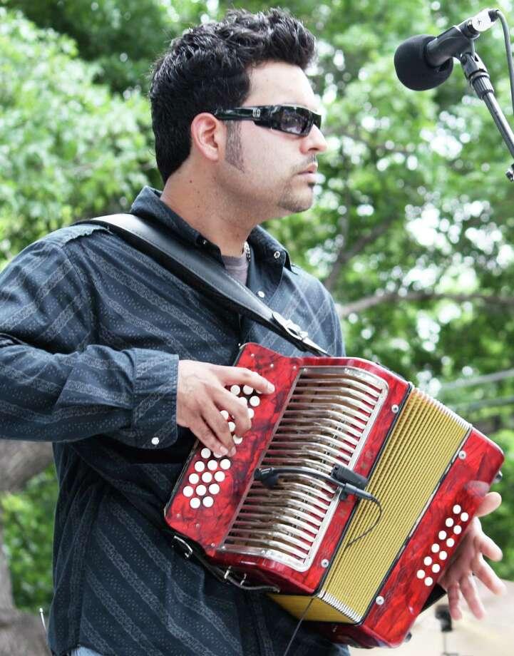 San Antonio accordion ace Michael Guerra celebrates his debut album at a CD release party Friday. Robert Johnson/ Express-News Photo: Robert Johnson, San Antonio Express-News / San Antonio Express-News