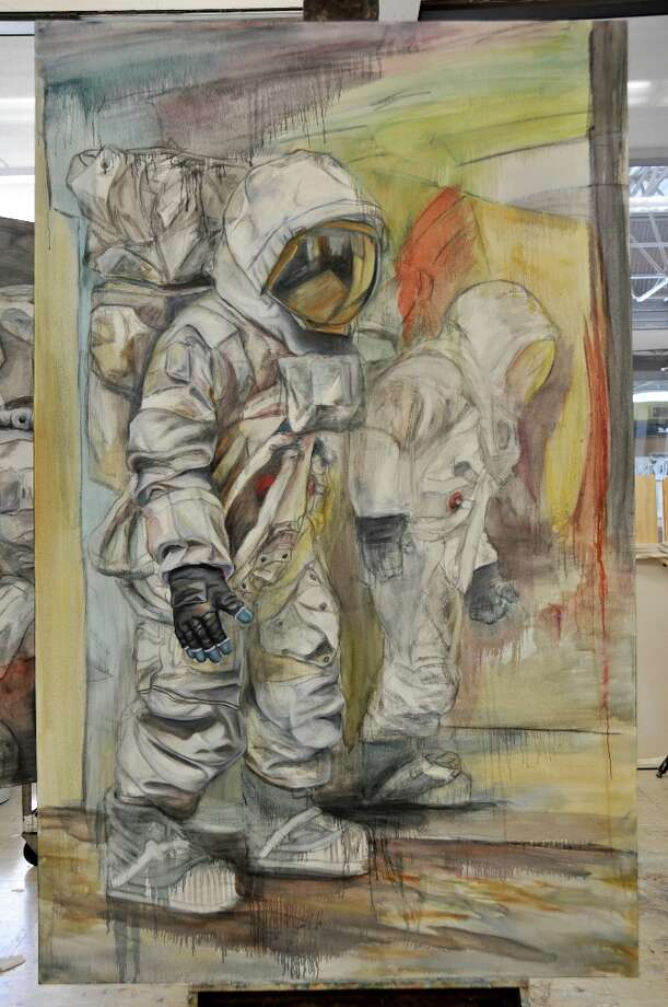 """Could Shoulder"" by Caleb Sims. ""My series of large oil paintings explore the theme of isolation,"" Sims said. ""The astronaut suit symbolizes a contradiction between the security of the suit and the isolation it causes by separating the wearer from all outside interaction."""