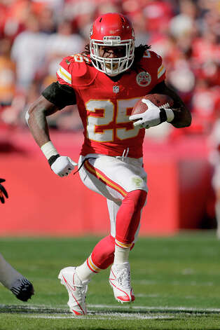 Kansas City Chiefs running back Jamaal Charles runs during the first half an NFL football game against the Denver Broncos Sunday, Nov. 25, 2012, in Kansas City, Mo. (AP Photo/Charlie Riedel) Photo: Charlie Riedel, ASSOCIATED PRESS / AP2012
