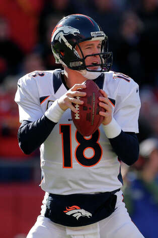 Denver Broncos quarterback Peyton Manning looks for a receiver during the first half an NFL football game against the Kansas City Chiefs Sunday, Nov. 25, 2012, in Kansas City, Mo. (AP Photo/Charlie Riedel) Photo: Charlie Riedel, ASSOCIATED PRESS / AP2012